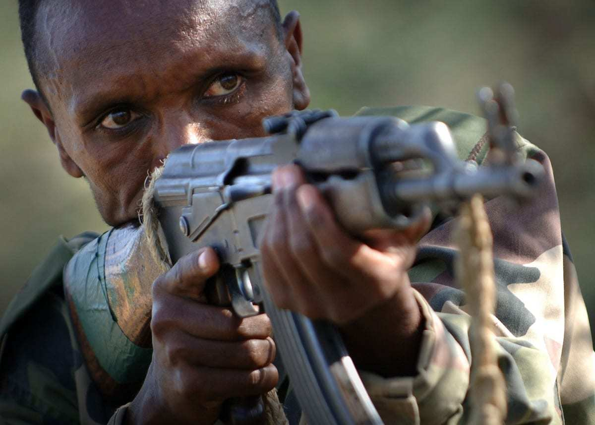 Ethiopian soldier aiming with an AK-47.