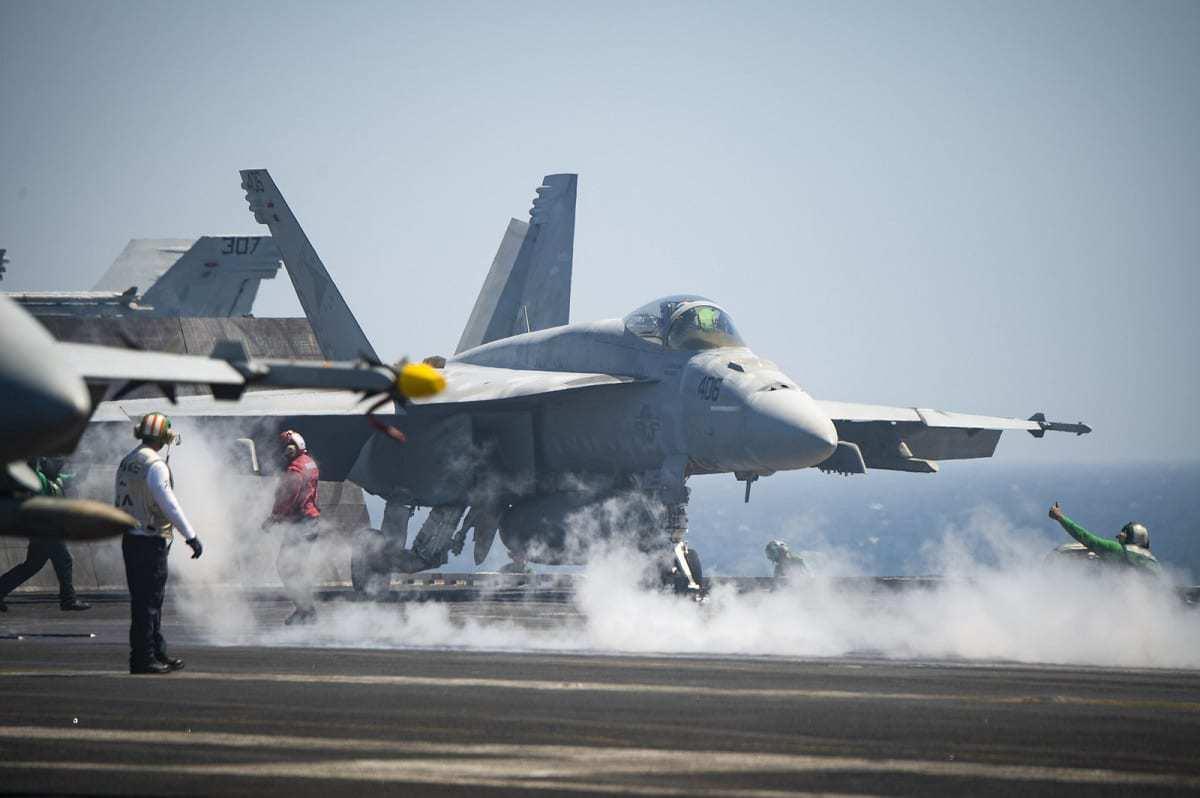 A U.S. Navy Official U.S. Navy PageFollow An F/A-18E Super Hornet prepares to launch from USS Harry S. Truman (CVN 75).