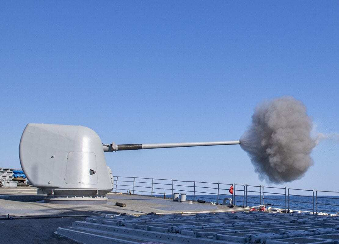 USS Normandy (CG 60) fires its forward Mark 45 mod 4 5-inch gun during a live-fire exercise.