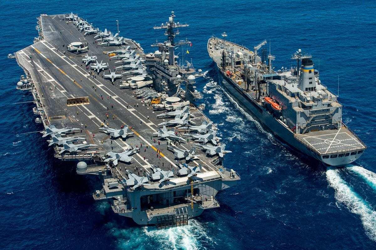 USS Carl Vinson (CVN 70) conducts a replenishment-at-sea with USNS Yukon.