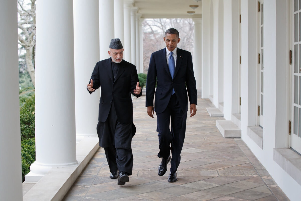 President Barack Obama and President Hamid Karzai of Afghanistan walk on the Colonnade of the White House